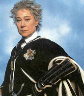 Movie still of Zoë Wanamaker as Madam Hooch.